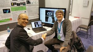 Andrey Fedorov (BWH) and David Flade (Brainlab) at QIRR booth.
